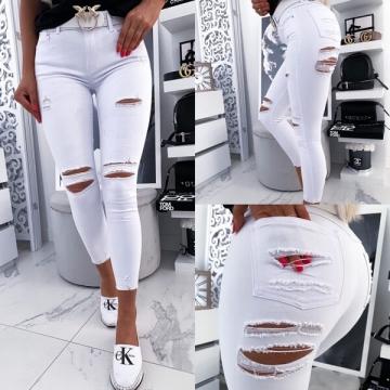 Białe spodnie jeans z dziurami