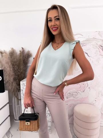 Miętowa damska bluzka z falbanką