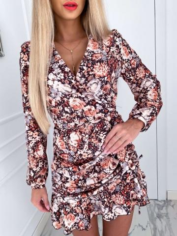 Sukienka w kwiaty z zakładanym dekoltem i długim rękawem