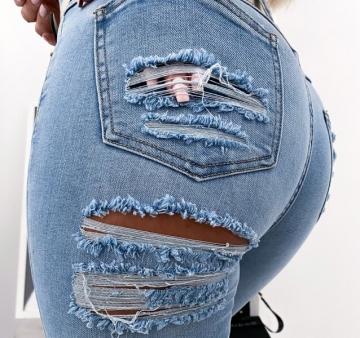 Niebieskie spodnie Dżinsy z dziurami